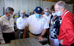 A detailed tour of CTB's Brock Grain Systems grain bin manufacturing facility was part of a visit to CTB, Inc. in Milford, Indiana, August 21 by U.S. Secretary of Agriculture Sonny Perdue (center). Steve Homme (right), Business Support Group Manager for Brock, led the tour and is showing Perdue Brock's popular TRI-CORR® Grain Bin Aeration Flooring. Accompanying Perdue (from left) were CTB Chairman and Chief Executive Officer Victor A. Mancinelli, Brock Plant Manager Tim Moore; Indiana State Department of Agriculture Director Bruce Kettler, and Indiana U.S. District 2 Representative Jackie Walorski. Perdue was at CTB for a town hall meeting with state and local area farmers and agribusiness representatives.